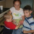 Camden, Ansley, Sam and Noah feeding Macen